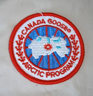 canada goose logo real vs fake